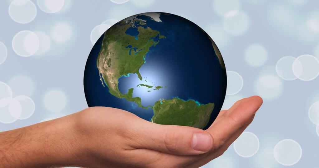 Earth Globe resting in a hand
