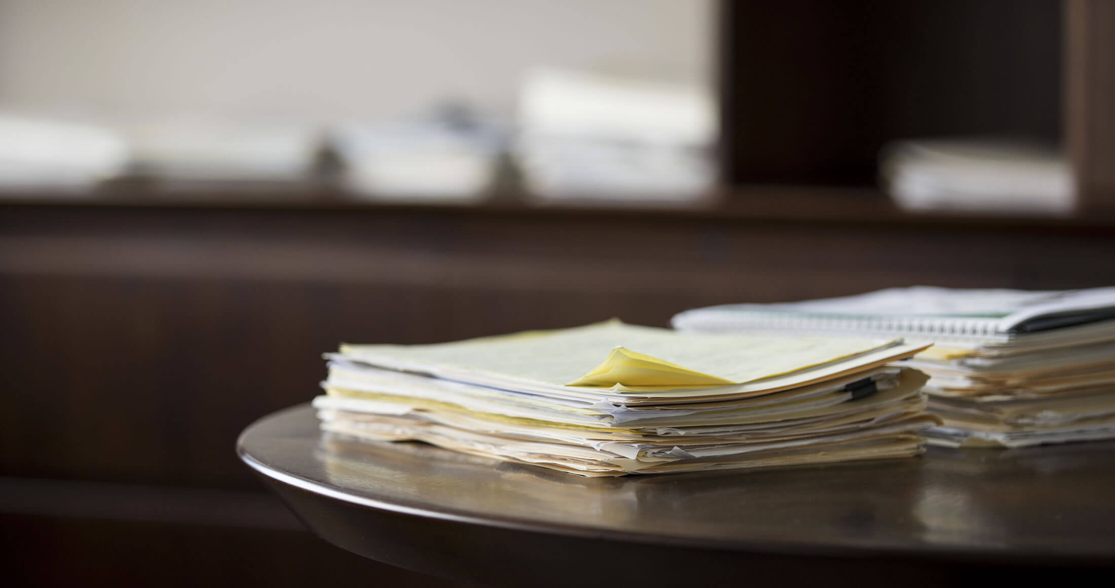 Stack of documents sitting on a table