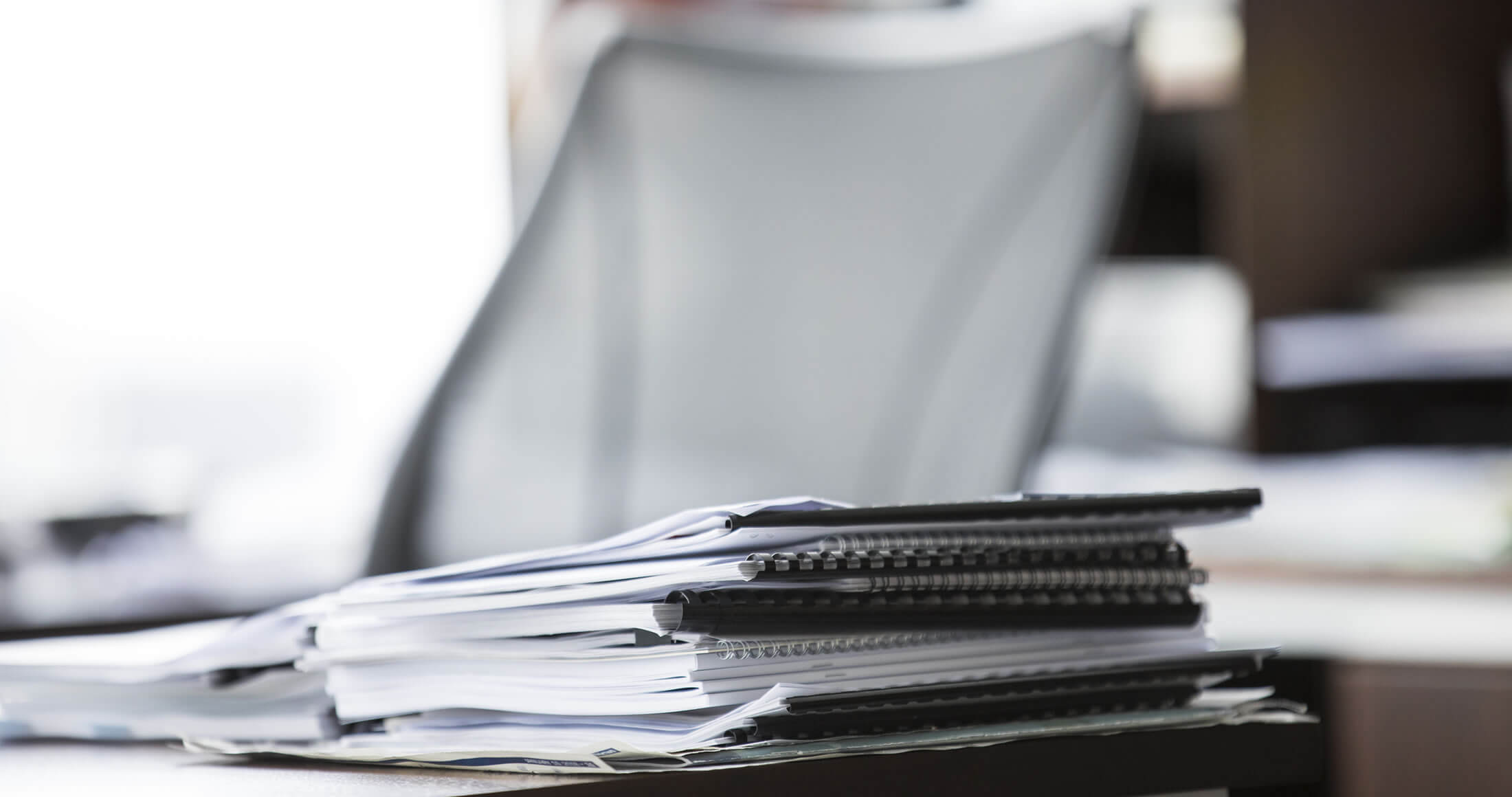 Stack of papers at a desk