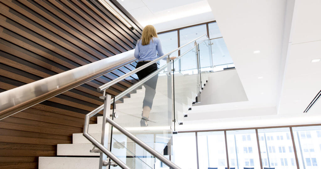 Woman walking up Harris Associates stairs